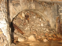 The end of the tunnel with a fine rustic stone arch